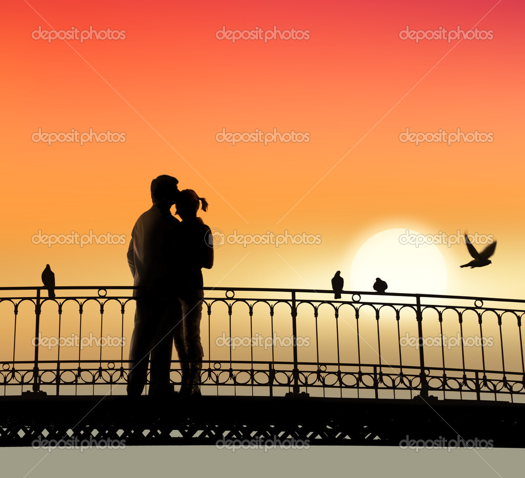 Silhouette of bridge and pair of lovers on sunset background  Stock Photo #2468987