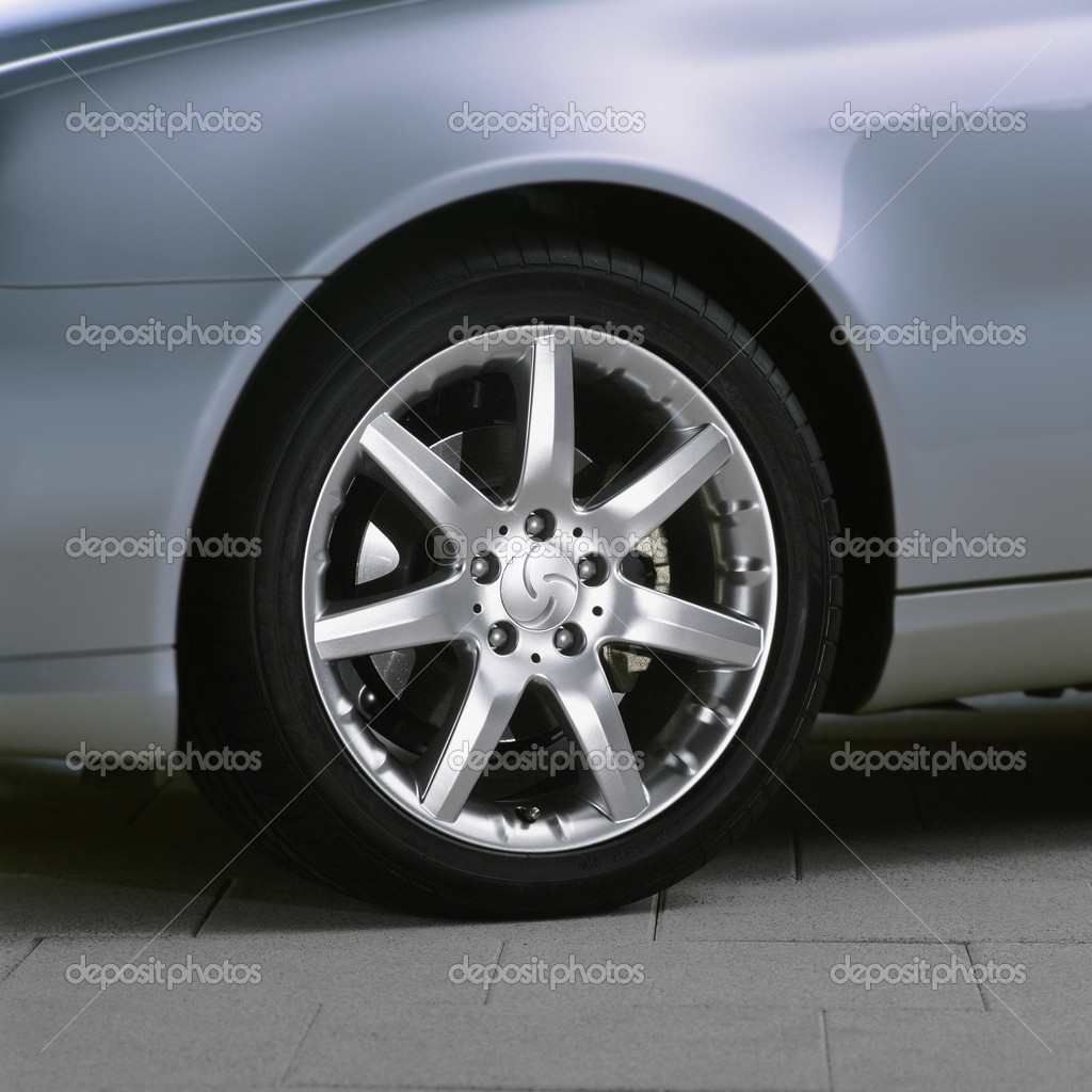 Metallic sport car wheel on the asphalt — Stock Photo #2469683