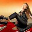 Blonde girl on a motorcycle - Stock Photo
