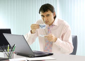 Businessman has a coffee break — Stock Photo