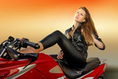 Blonde girl on a motorcycle — Stock Photo