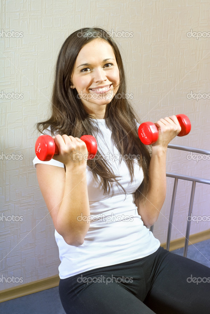 Happy beautiful young brunette girl working out  Stock Photo #2470257