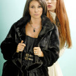 Two young women in fur coats — Stock Photo