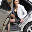 Stock Photo: Businesswomalighting from car