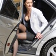 Stock Photo: Businesswoman alighting from car