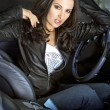 Expressional woman in the sportcar - Stock Photo