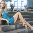 Sad blonde in turquoise dress - 