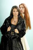 Two young women in fur coats — Stock Photo