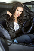 Expressional woman in the sportcar — Stock Photo