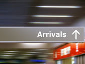 Tourist info signage arrivals — Stock Photo