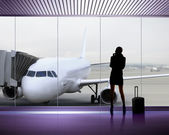 Silhouette of woman at the airport — Stock Photo