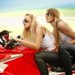 Two blonde on a motorcycle — Stock Photo