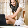 Girl with notebook computer at home — Stock Photo #2512204