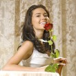 Stock Photo: Girl with rose