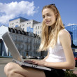 Collegian near a modern building — Stock Photo