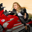 One blonde on a motorcycle - Stock Photo