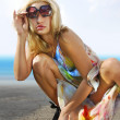 Smart blonde on coast — Stock Photo