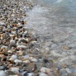 Pebbly shore of red sea - Stock Photo