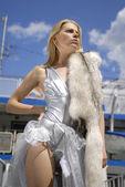 Girl with polar fox on a ship deck — Stock Photo