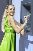 Blonde near a cash machine — Stock Photo