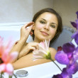 Stock Photo: Womin bath with flower petals