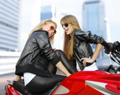 Two cheery motorcyclists and motorcycle — Stockfoto
