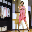 Woman fits on a dress - Foto de Stock