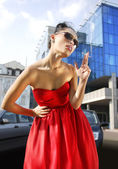 Smoking lady in red dress — Stock Photo