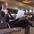 Businessman and airport — Stock Photo