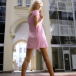 Long-legged blond woman - Stock Photo