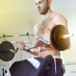 Man in exercise room — Stock Photo