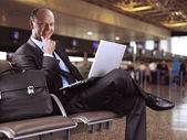 Businessman and airport — Stock fotografie