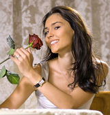 Laughing girl with rose — Stock Photo