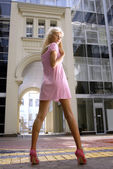 Long-legged blond woman — Stock Photo
