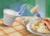 Vareniks and sour cream — Stock Photo