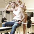 Couple in exercise room — Stock Photo #2610069