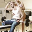 Couple in exercise room - Stock Photo
