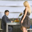 Courting couple and blonde waitress — Stock Photo
