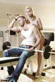 Couple in exercise room — Stock Photo