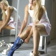 Blonde fits on a modern blue boots — Stock Photo