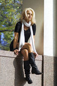 Beautiful young woman in autumnal city — Stock Photo