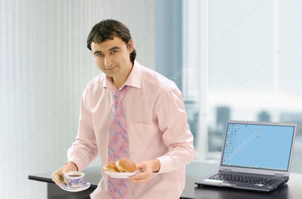 Businessman near his work place that has a coffe break — Stock Photo #2639295