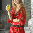 Blonde in modern kitchen with juice — Stock Photo