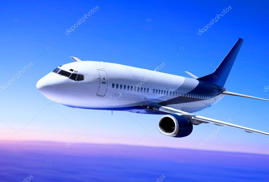 Passenger airplane in the blue sky landing away  Foto Stock #2657408