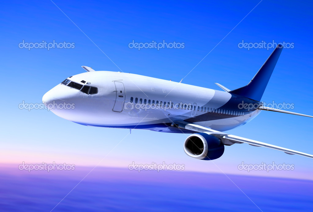 Passenger airplane in the blue sky landing away — Lizenzfreies Foto #2657408