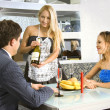 Courting couple and waitress — Stockfoto