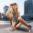 Fashion blonde model on a street - Stock Photo