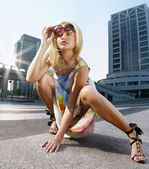 Fashion blonde model on a street — Stock Photo