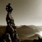 Mountain scenery - man on a rock top — Stock Photo