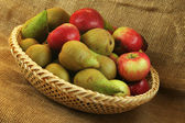 Apples and pears on a bowl — Stock Photo